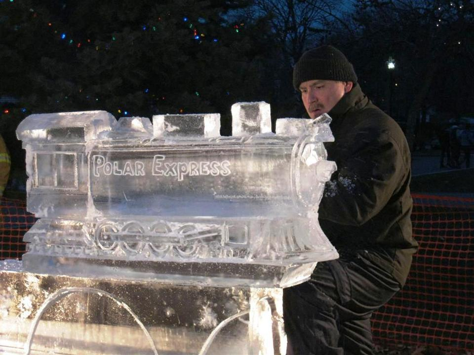 Eric Fontecchio carves ice at the Stoneham tree lighting.