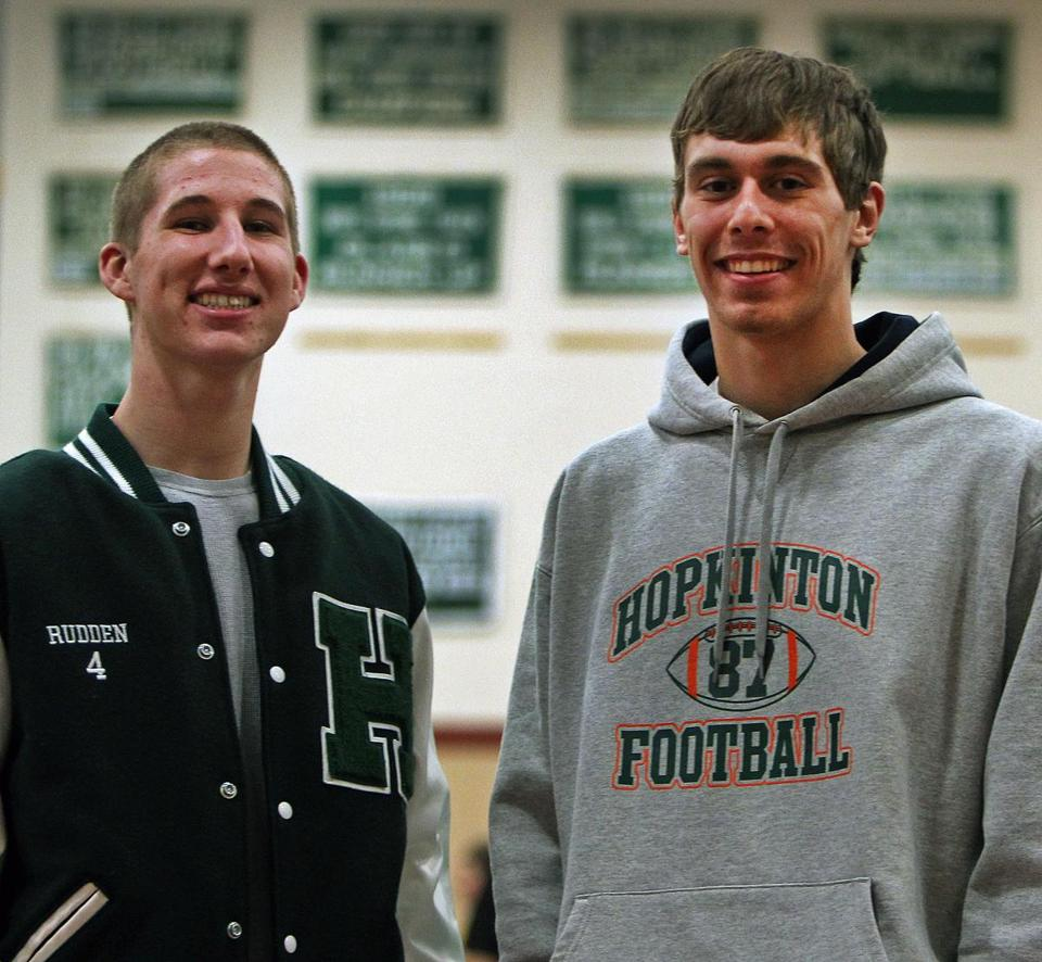 Hopkinton High School football players Hank Rudden (left) and Shaun Palmer (right) pose together in the school's gymnasium.