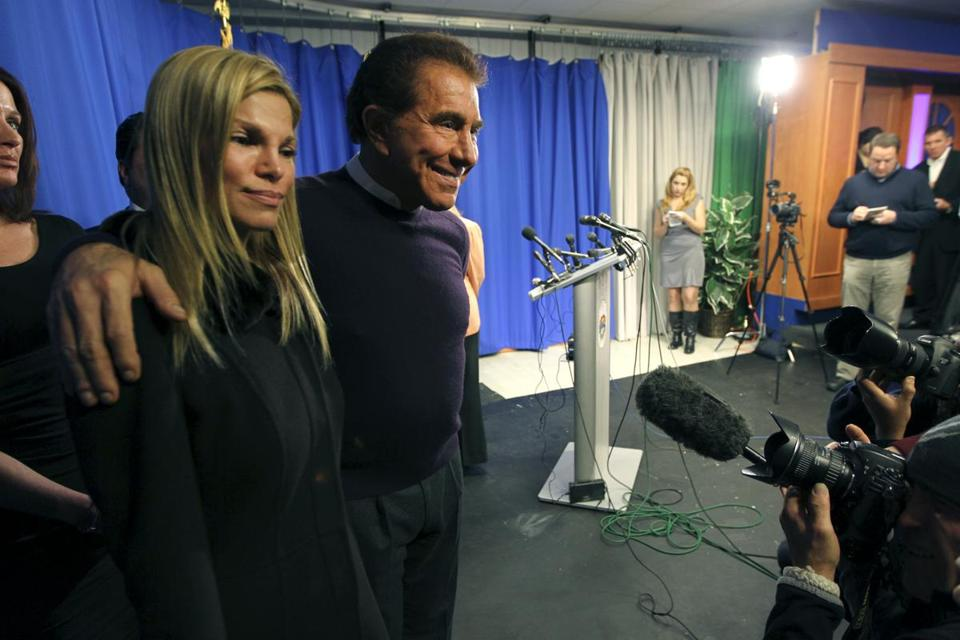 Wynn Resorts CEO Steve Wynn and wife Andrea Hissom left after a press conference at Everett City Hall.