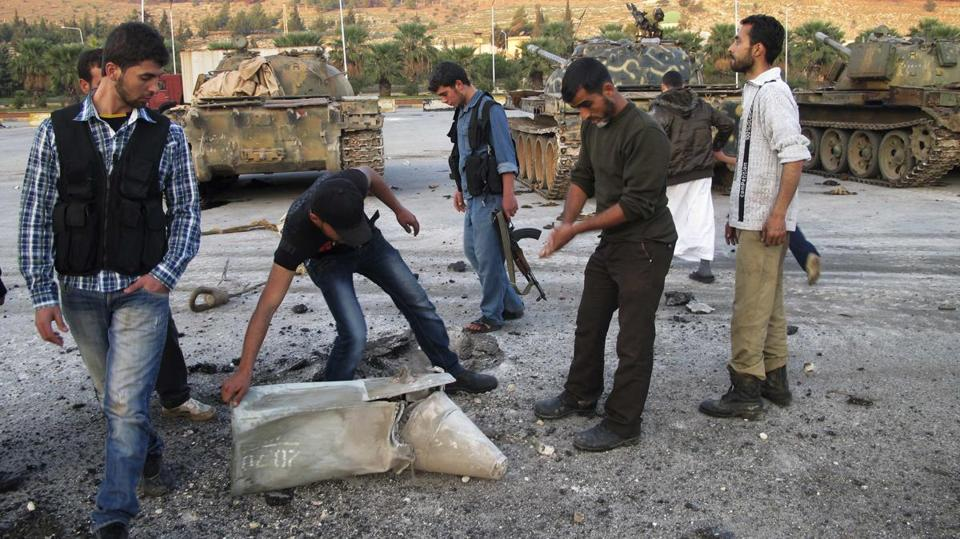 Free Syrian Army fighters inspected ammunition they said was fired at their military base by government forces.
