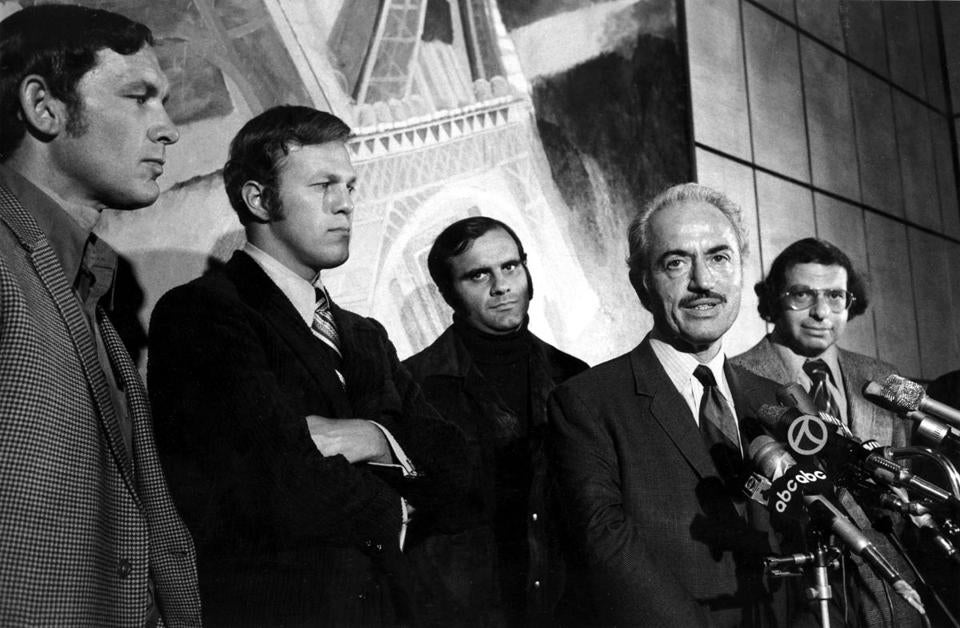 Marvin Miller announced an end to a players' strike in 1972 with (from left) Gary Peters of the Red Sox, Wes Parker of the Dodgers, Joe Torre of the Cardinals, and lawyer Dick Moss.