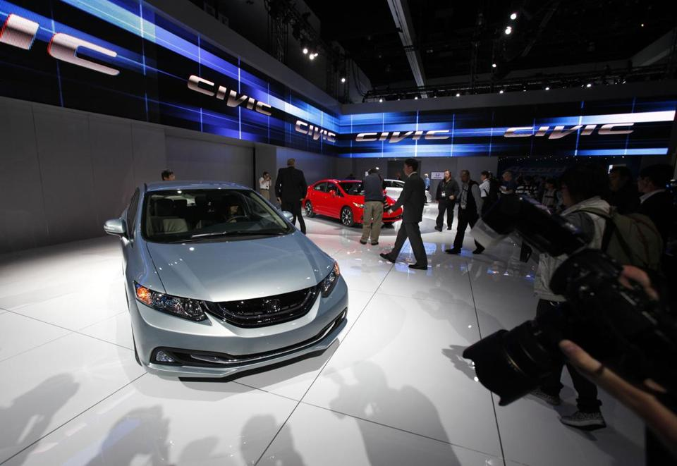 In an unusual move, a revamped 2013 Honda Civic went on sale Thursday, 19 months after the 2012 model came out. The new model has a sportier profile, analysts say.
