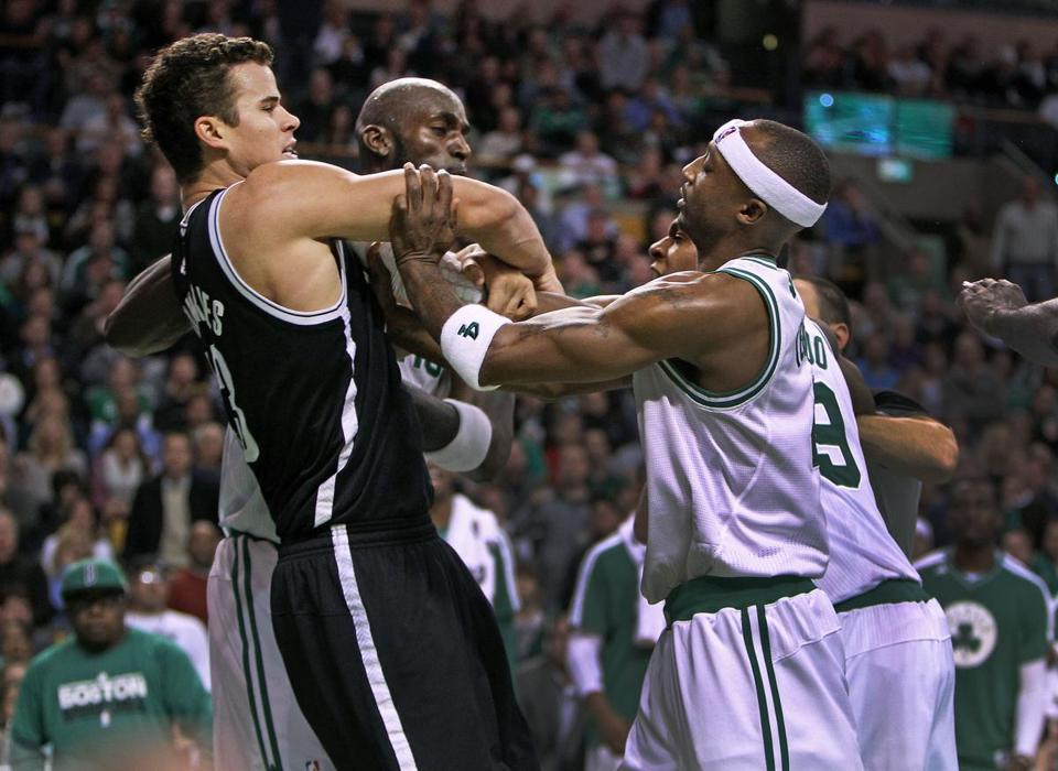 Kevin Garnett, center, was at the heart of the fight between Rajon Rondo and Kris Humphries on Wednesday.
