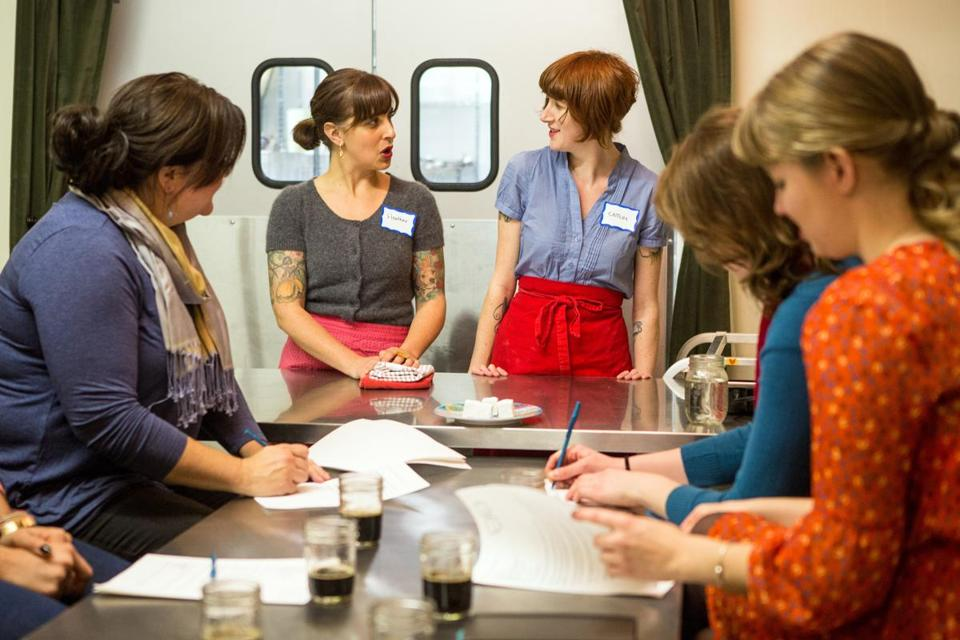 Heather Schmidt (center left), founder of City Chicks, and confectioner Caitlin Barry (center right) teaching a cooking class in Somerville.
