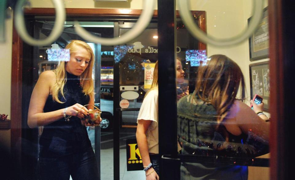 Jillian Donham headed inside O'Connell's Pub. As the student population grows at Framingham State, more activity can be seen on campus and around town.