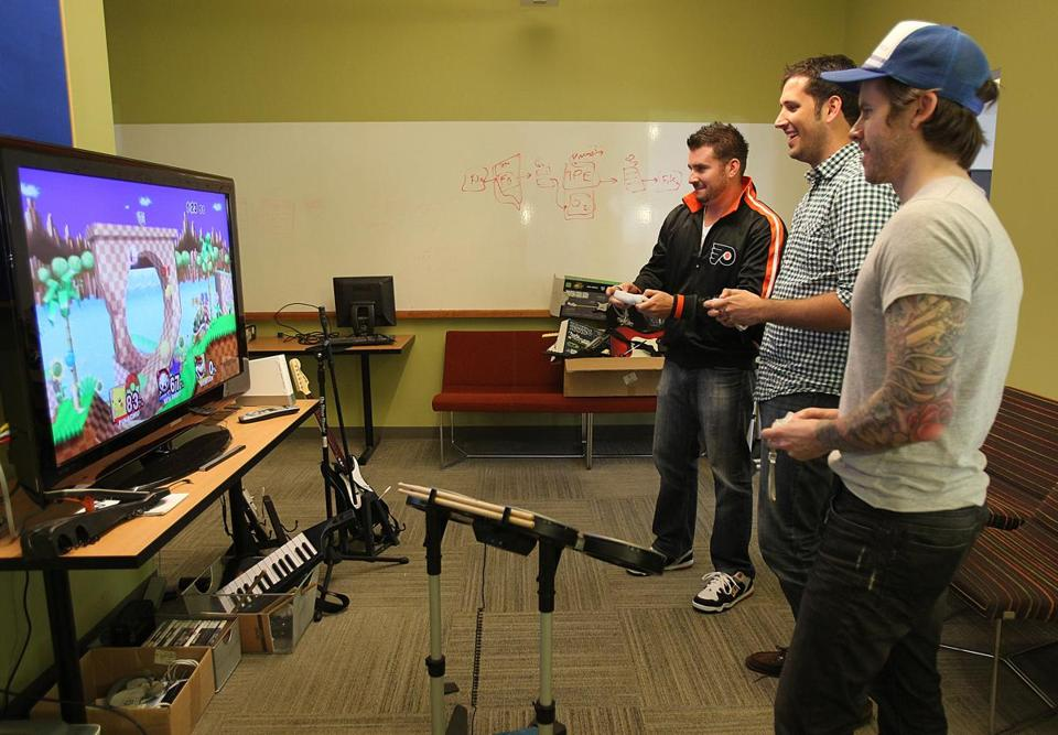 Employees can work off energy in the game room at TripAdvisor's Newton headquarters.