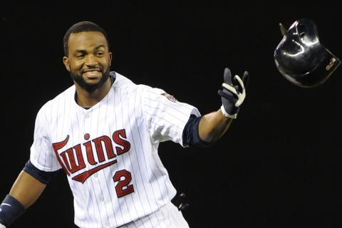 Minnesota Twins' Denard Span celebrates his walkoff RBI double during to a baseball game against the Kansas City Royals Thursday, Sept. 13, 2012 in Minneapolis.