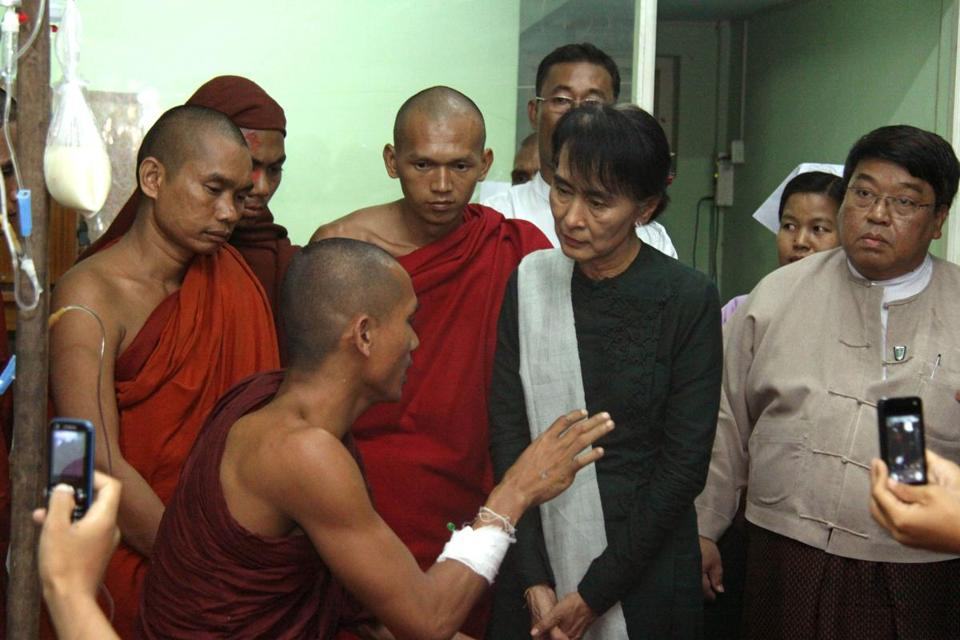 Aung San Suu Kyi listened to a Buddhist monk at a hospital in Monywa, Myanmar, last week. The monk said he was injured by forces cracking down on a copper mine protest.