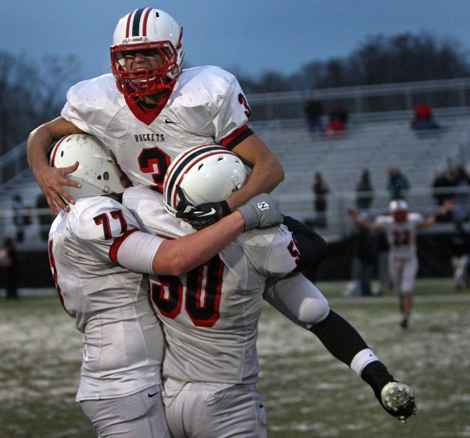 Jared Barros (3) and his Reading teammates celebrated their Super Bowl win over Mansfield.