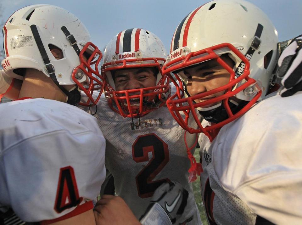 Alex Valente (2) was in the middle of Reading's celebratory huddle; he gained 161 yards on eight carries and scored a touchdown.