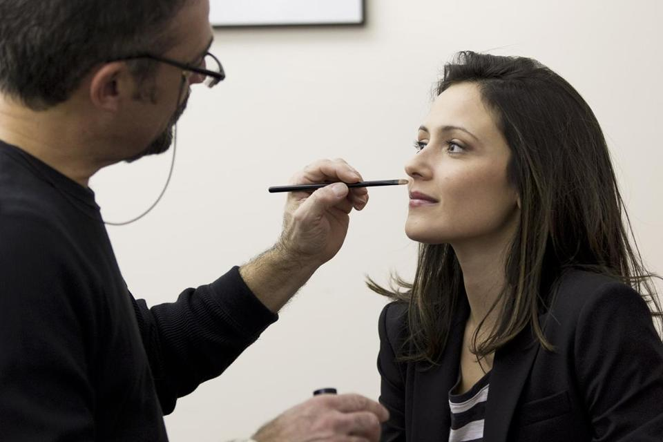 "Makeup artist Joe Rossi works on Italia Ricci, who stars in the ABC Family channel pilot ""Terminales."""