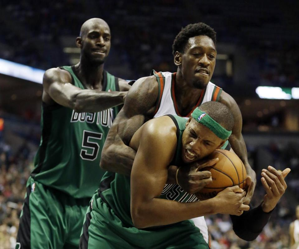 Kevin Garnett watched as Paul Pierce and Larry Sanders battled for a loose ball in the second half.