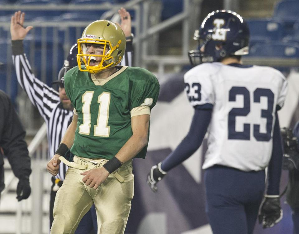 Bishop Feehan's Nicholas Romero (11) lets everyone know he just scored, including Lynnfield's Cameron Rondeau.
