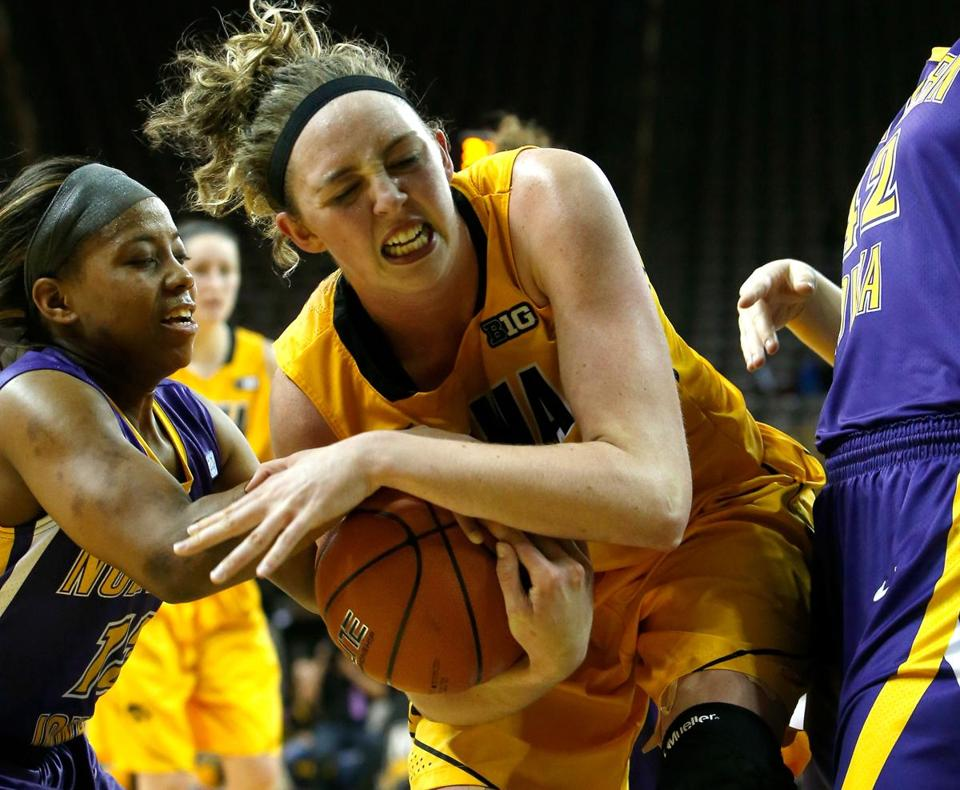 Iowa's Morgan Johnson draws a foul on Northern Iowa's Sharnae Lamar (left) while driving to the hoop.