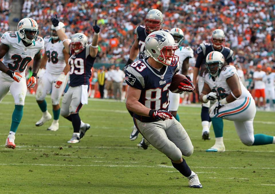 Wes Welker is all alone as he walks into the end zone with a second-quarter TD, which DannyWoodhead (39) celebrates.
