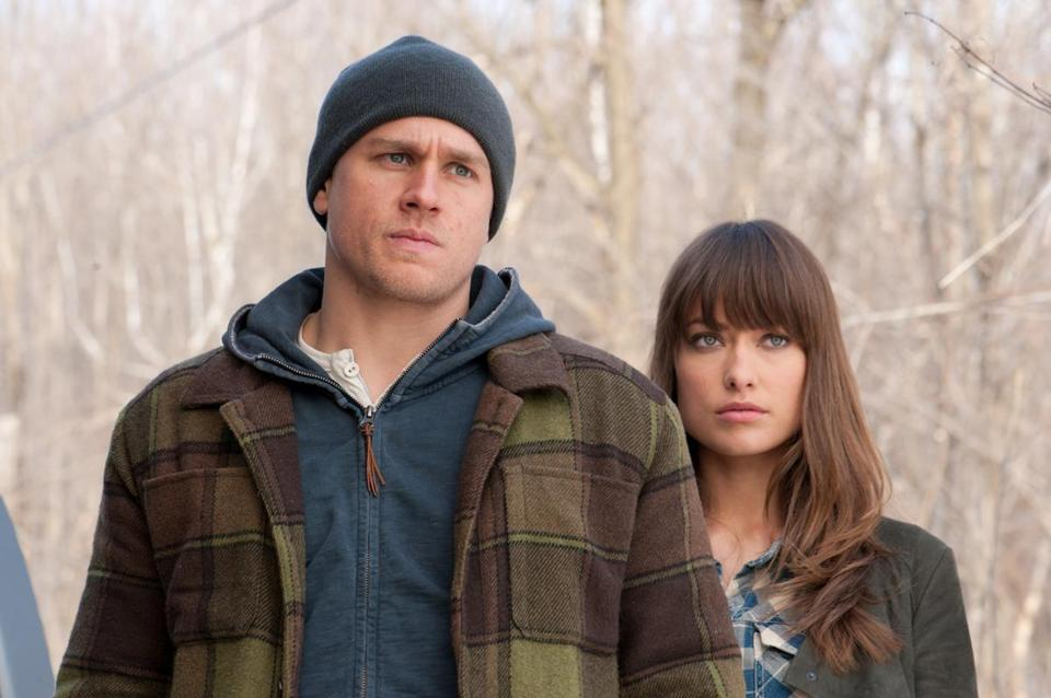 "Charlie Hunnam and Olivia Wilde in ""Deadfall."""