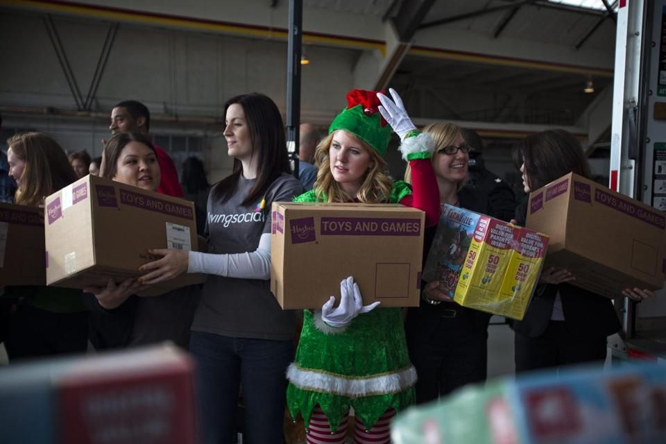 Volunteers at Washington Reagan Airport loaded toys on Monday for delivery to the storm-stricken New Jersey coastline.