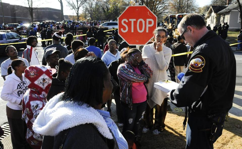 Parents listened as an official read the names of students taken to the hospital from Finch Elementary School in Atlanta.