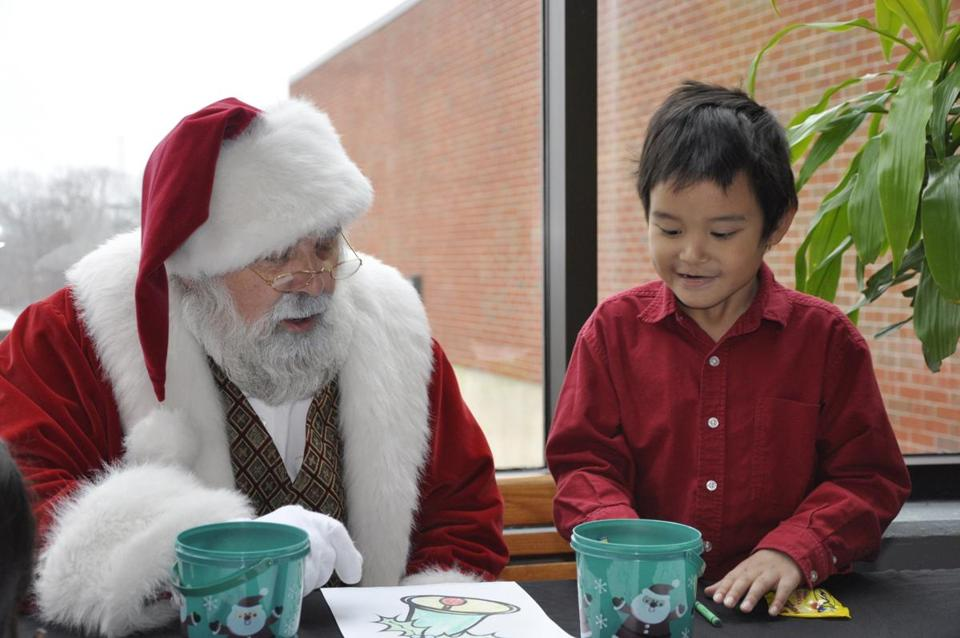 Santa Claus at Watertown's Arsenal Mall spends time with Anon Unseetheharuthai, 6, a Watertown resident who was diagnosed with autism.