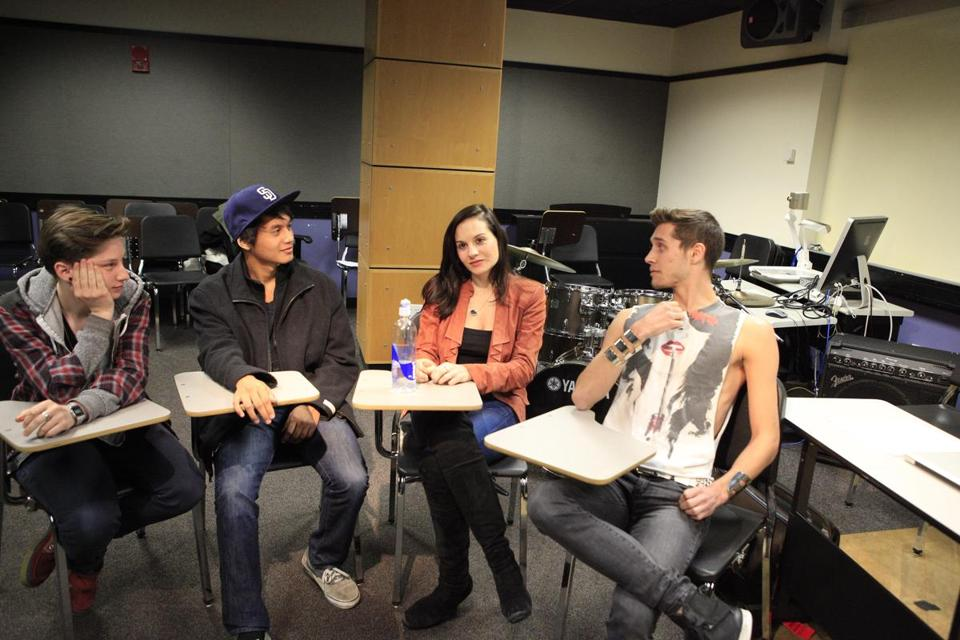 "Songwriter/Berklee College of Music professor and former ""American Idol"" judge Kara DioGuardi sits with her some of her students."