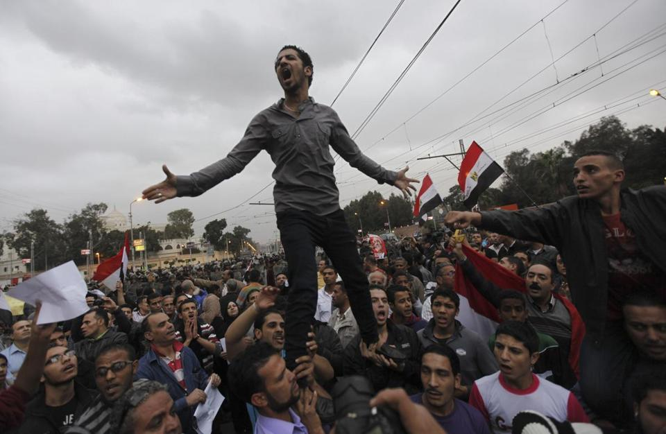 Tens of thousands marched to the presidential palace Tuesday in Cairo, protesting the country's draft constitution. Police fired tear gas, then retreated inside the compound.