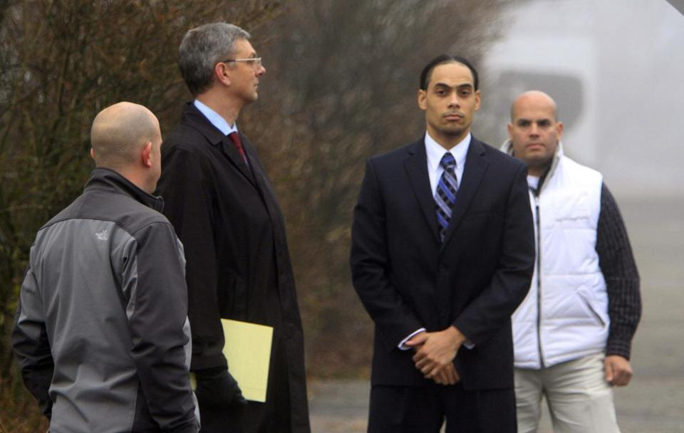 Myles Webster (second from right) joined jury members looking at the crime scene Tuesday in Manchester, N.H.