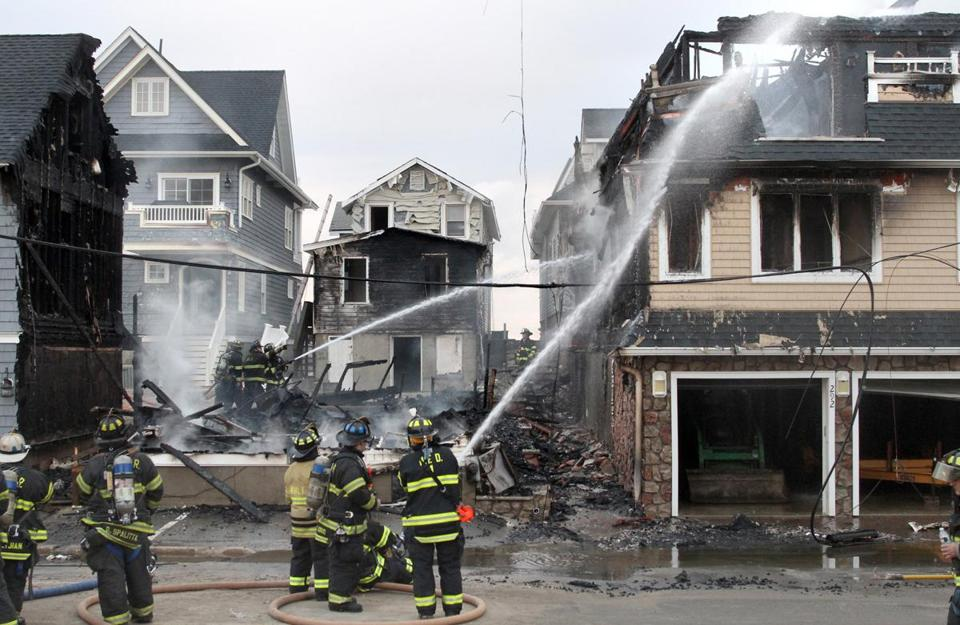 Firefighters worked on the blazes in homes in Manasquan, N.J., already flood-damaged by Sandy.