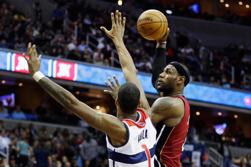 A triple-double (26 points, 13 rebounds, 11 assists) by LeBron James wasn't enough to finish off Trevor Ariza and the Wizards.