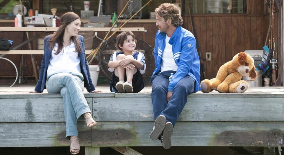 "Jessica Biel, Noah Lomax, and Gerard Butler in ""Playing for Keeps."""