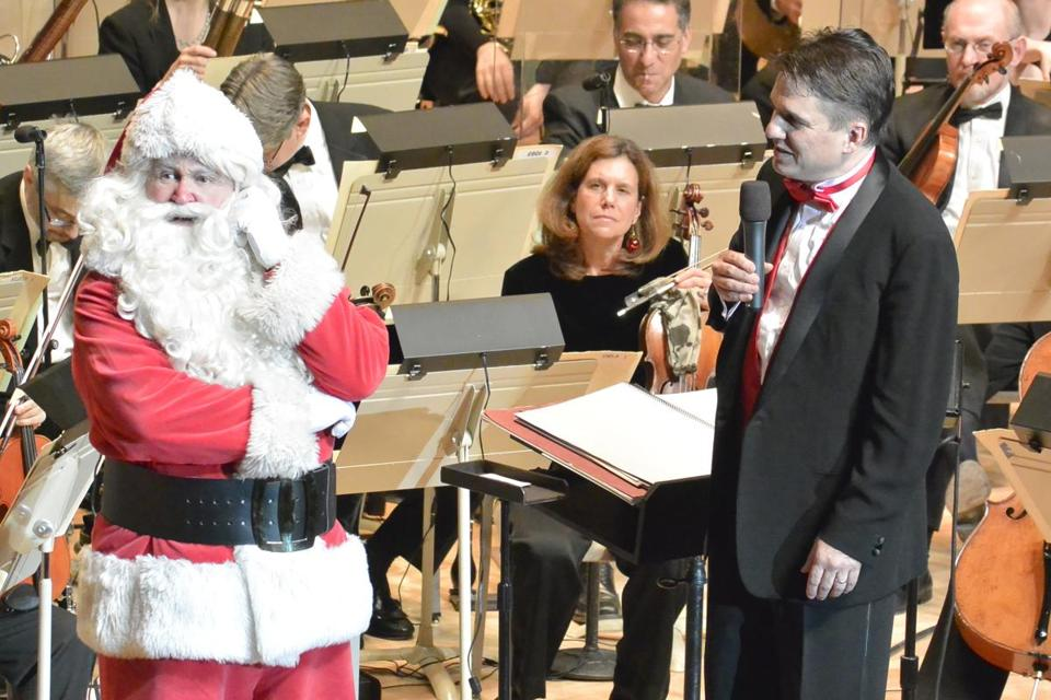Santa Claus makes a special stop to visit with Keith Lockhart on opening night of the Holiday Pops earlier this month at Symphony Hall.