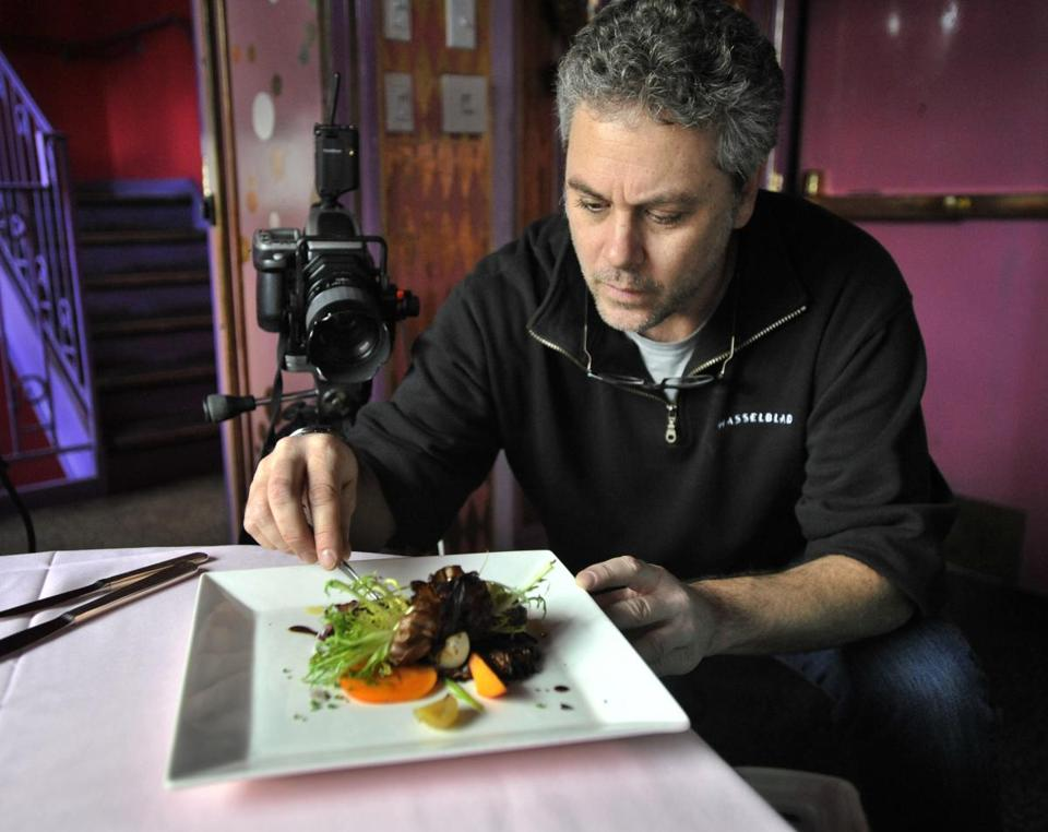 Andy Ryan set up a photo at Upstairs on the Square in Cambridge. Other clients have included The Cheesecake Factory and Food and Wine magazine.