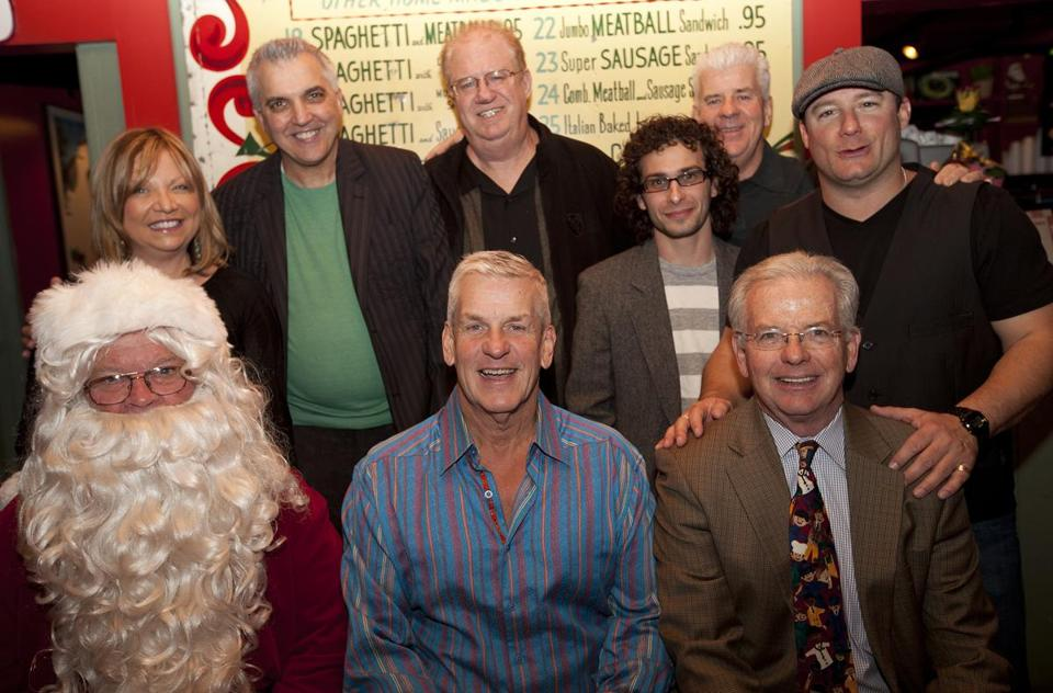 "Trisha Castraberti, owner of Prince Pizzeria in Saugus, with comedians Jack Pizzi, Tumblin' Jack Walsh, Anthony Scibelli, Mike Clarke, Dave Russo, Lenny Clarke, and Globe Santa Fund director Bill Connolly at ""A Sleigh Full of Laughs"" benefit."