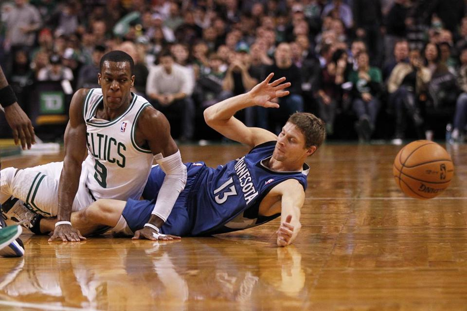 Rajon Rondo and Minnesota's Luke Ridnour hit the deck after Rondo forced a turnover with some tough defense in his first game back from suspension.