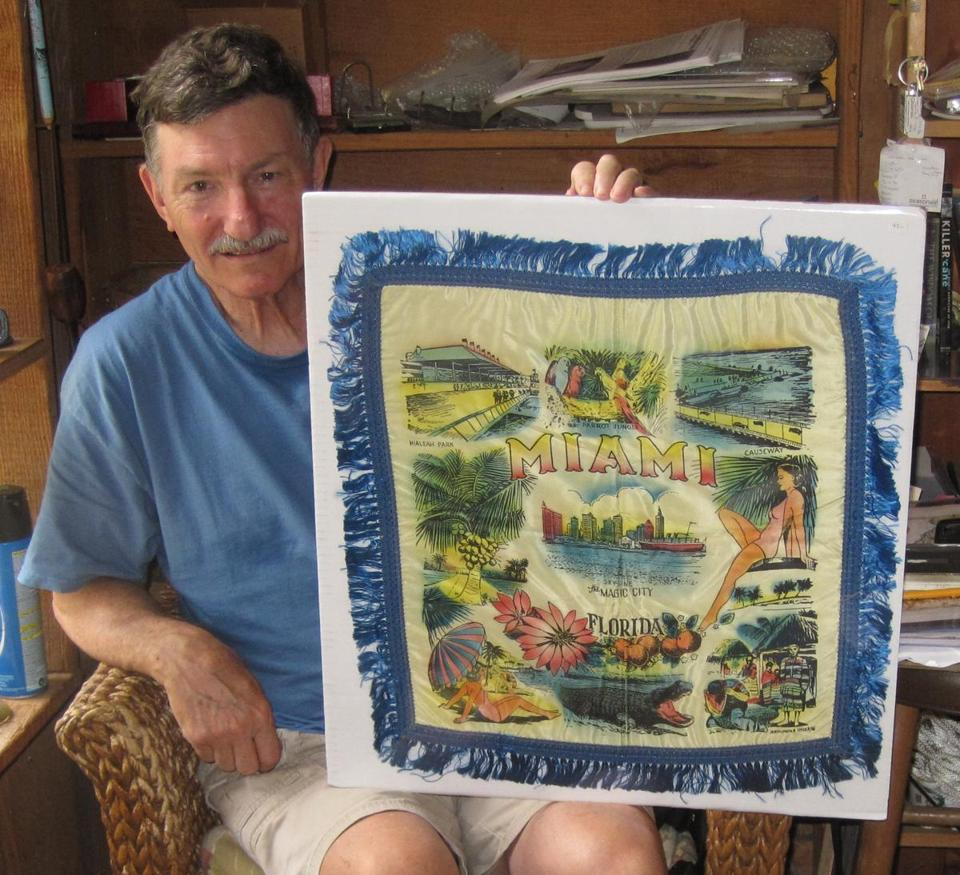At Roberts Antiques in Micanopy, Fla., Larry Roberts displays a 1950s souvenir Miami pillow sham.