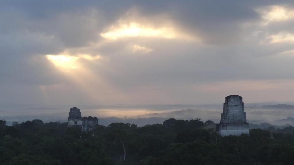 Sunrise over Tikal National Park on a tour started under starry skies.
