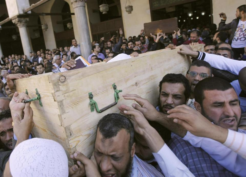 Members of the Morsi-allied Muslim Brotherhood carried a coffin in Cairo.