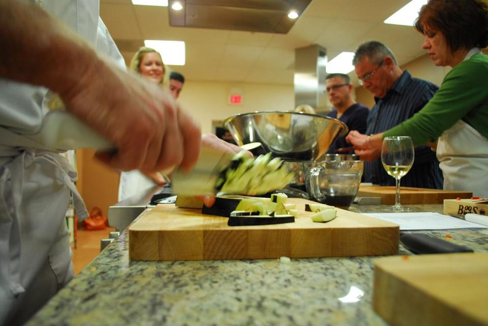 Chef Bernard Kinsella chops ingredients for his cooking class at The Good Life Kitchen in Norwell.