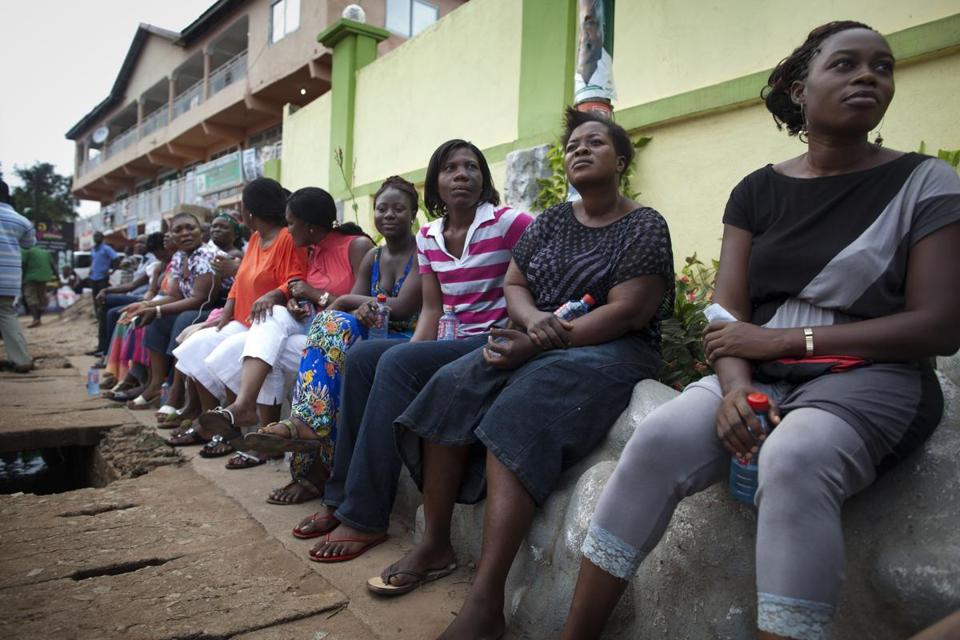 Voters sat and waited yesterday in Accra, three hours after biometric identification machines had broken down.