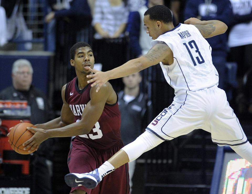 Wesley Saunders led Harvard with 14 points, but DeAndre Daniels scored 23 points to lead Connecticut to a 57-49 win Friday night.