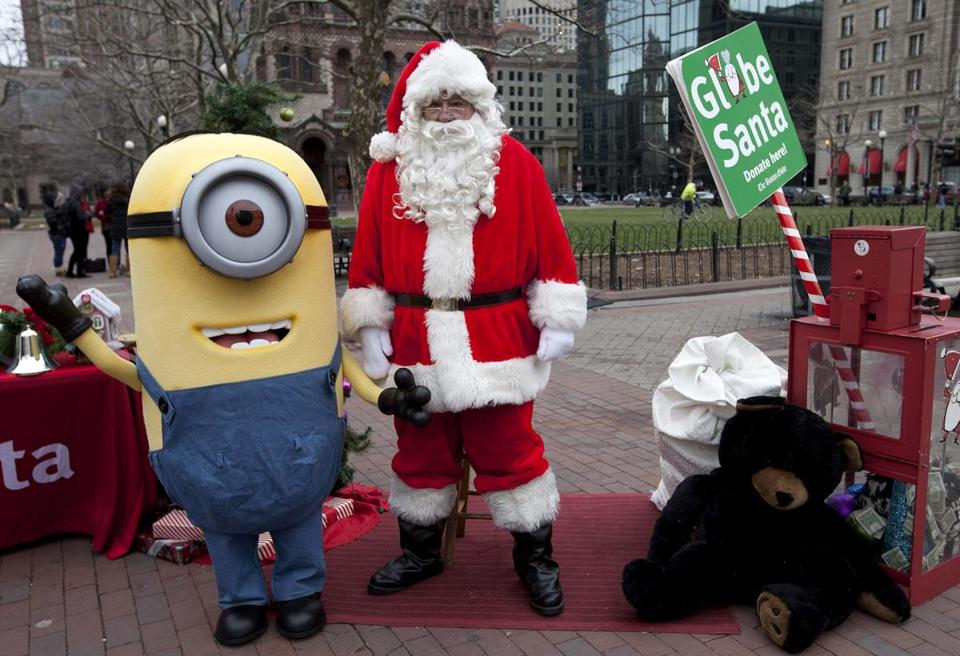 "A character from the Universal Pictures' movie ""Despicable Me"" gave Globe Santa a hand in Copley Square Sunday."