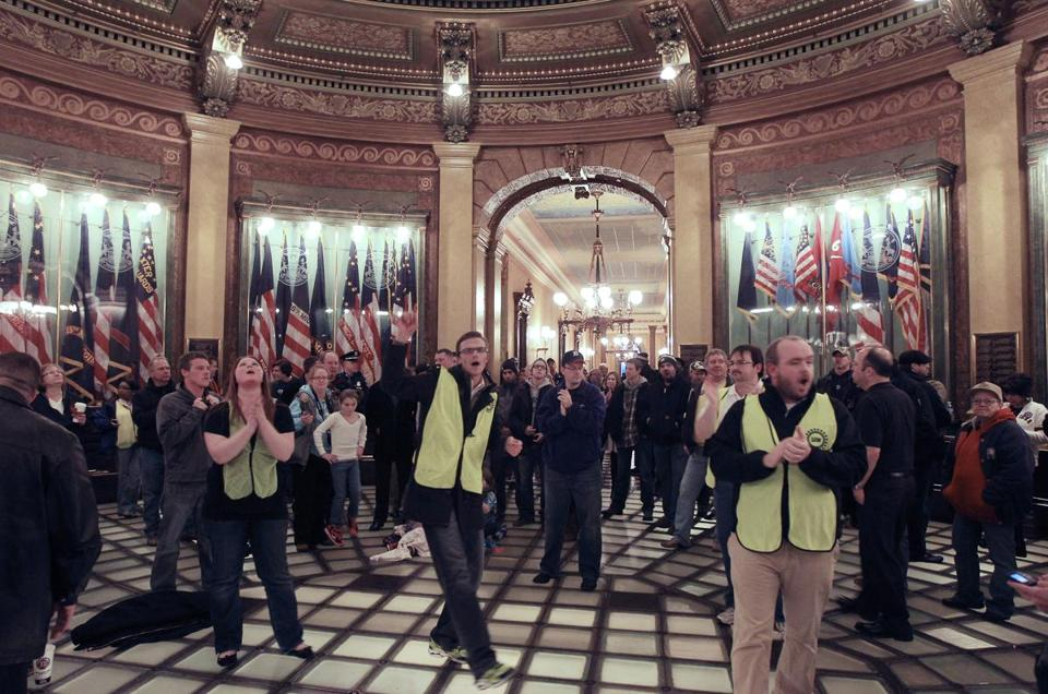 Union workers chanted at a demonstration in the Capitol rotunda in Lansing, Mich., on Thursday. The crowd walked in during lawmakers' debate of the right-to work bill.