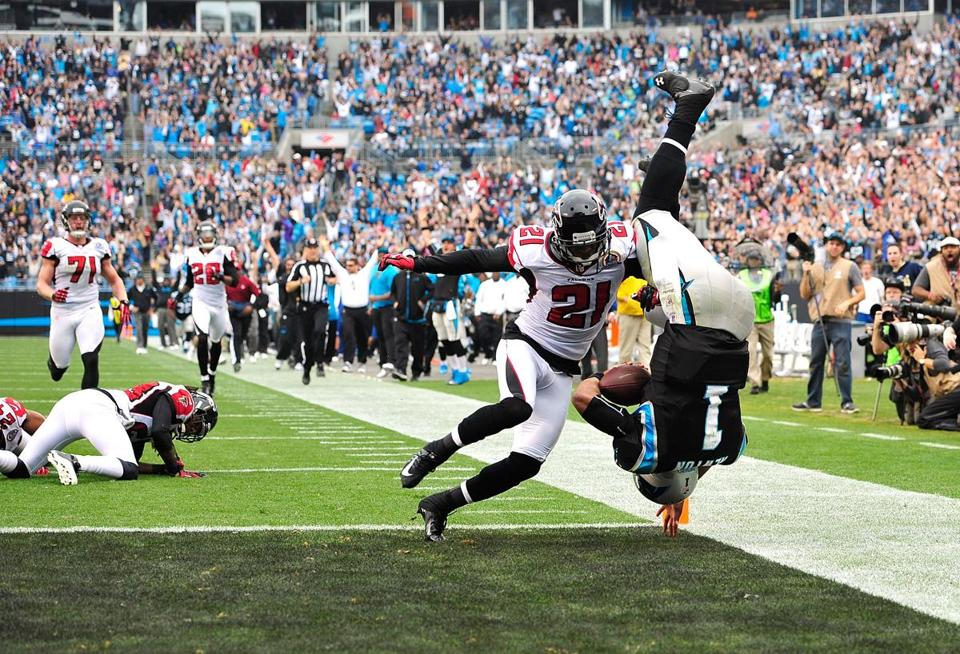 Cam Newton dives past Atlanta's Christopher Owens to cap a 72-yard TD run.