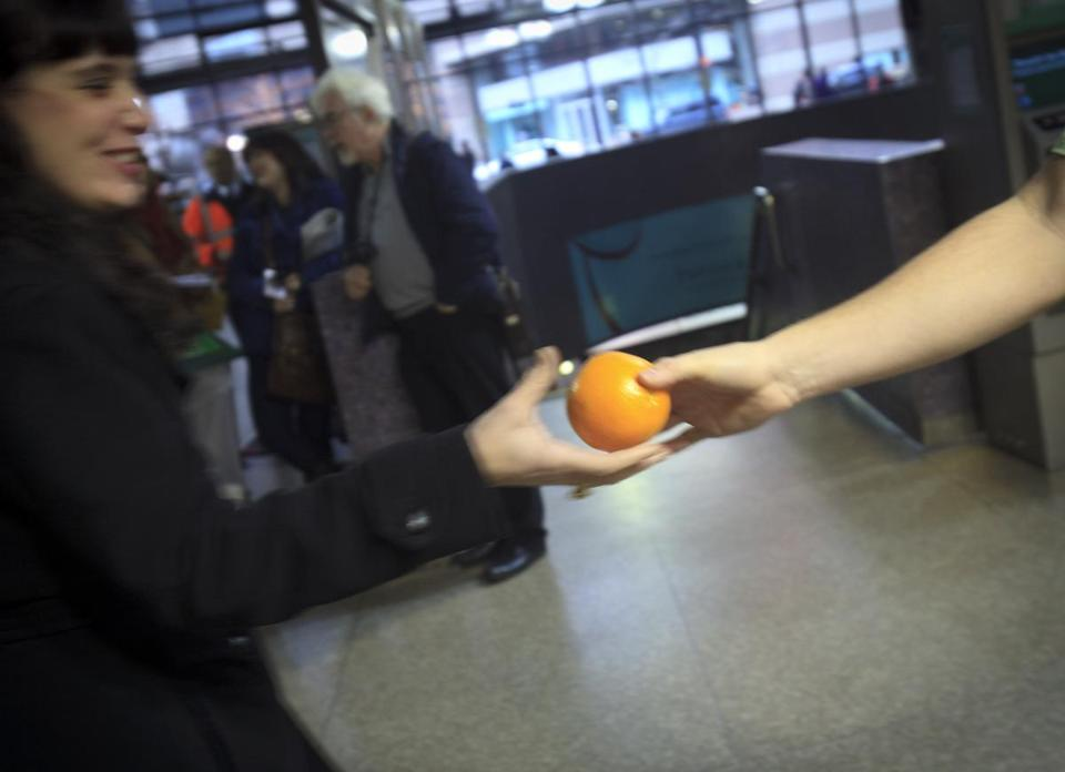 A commuter gladly accepted an orange from a member of Samaritans at Back Bay station earlier this month.