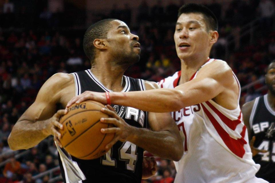 Houston's Jeremy Lin (right) had the hot hand with 38 points, but Gary Neal (left) had 29 in the Spurs' fifth straight victory.
