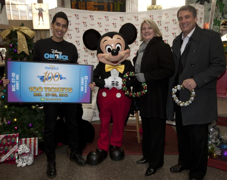 Disney On Ice skater Tommy Do, Mickey Mouse, TD Garden president Amy Latimer, and Boston Bruins president Cam Neely made Globe Santa donations at South Station.