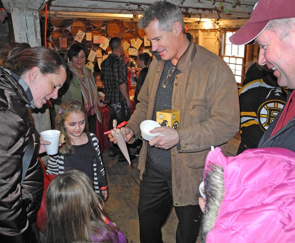 Senator Scott Brown showed off Christmas gifts he picked up as he visited Smolak Farms in North Andover on Saturday for a trees-for-troops fund-raising event.