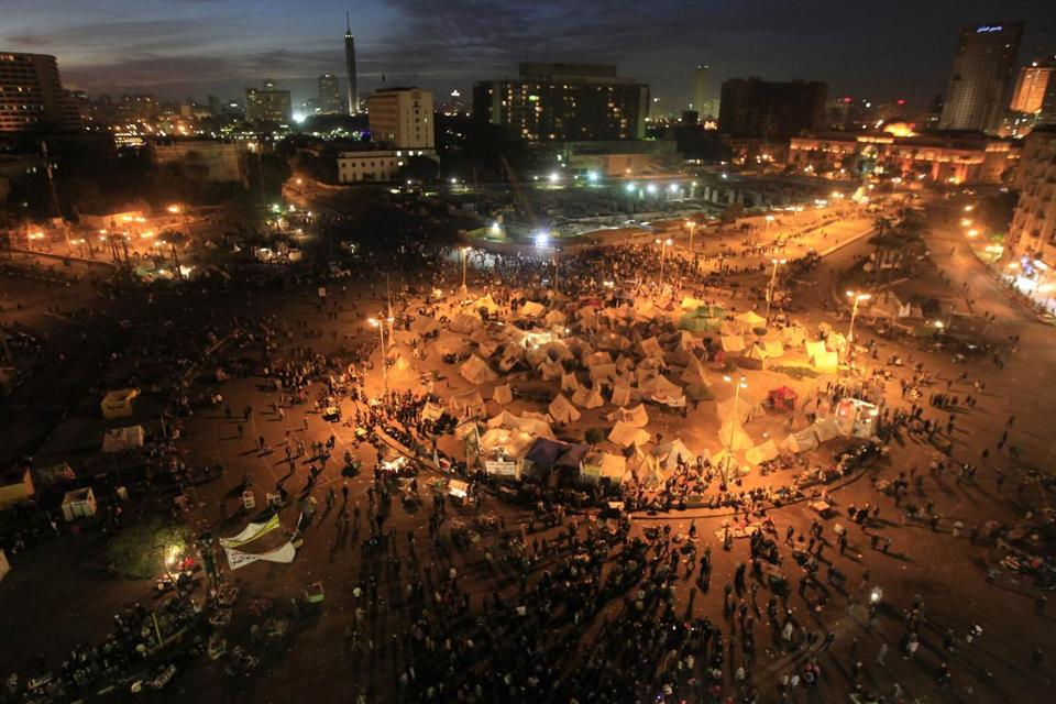 Nine people were hurt when gunmen fired at protesters camping in Cairo's Tahrir Square on Tuesday, according to witnesses and the Egyptian media.