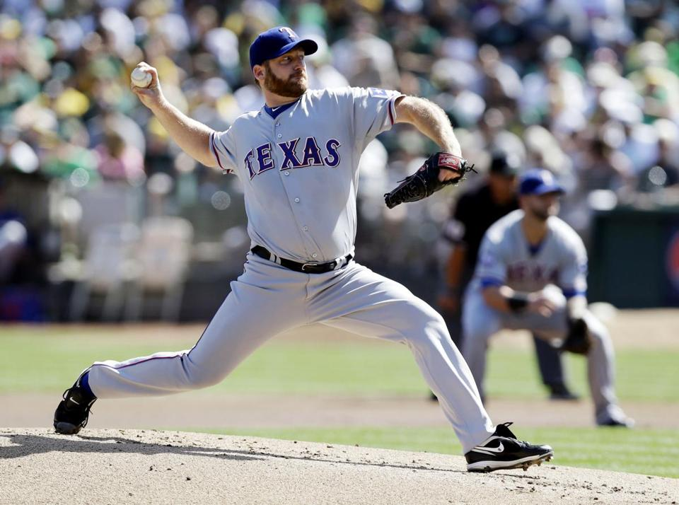 Ryan Dempster moved from the Cubs to the Rangers last season.