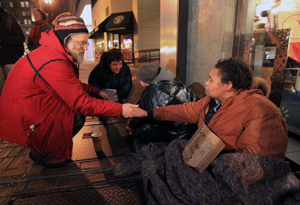 Jim Greene and Beth Grand spoke with two homeless people on Washington Street Wednesday night.