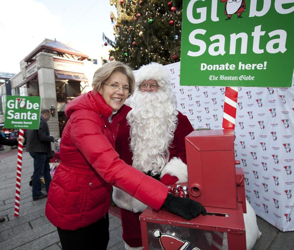 Senator-elect Elizabeth Warren helped Globe Santa Thursday at Faneuil Hall. Many letter writers to Globe Santa are single mothers struggling to raise children with litte help.